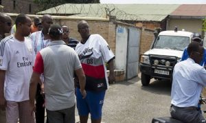 Family members gathered outside the Bikomagu home after the attack.