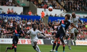 Dede Ayew rose high above Coloccini to head home his 2nd Premier League goal.