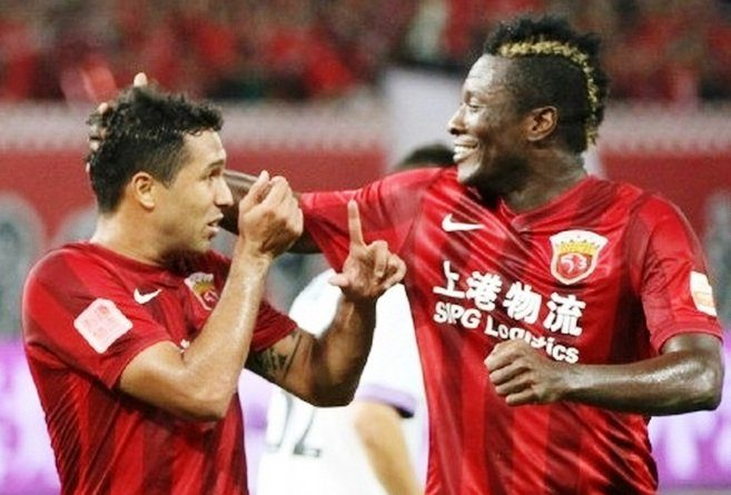 Asamoah Gyan is quietly racking up the goals in China .