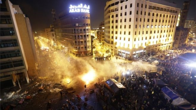 Police responded with tear gas and water cannon for a second night.