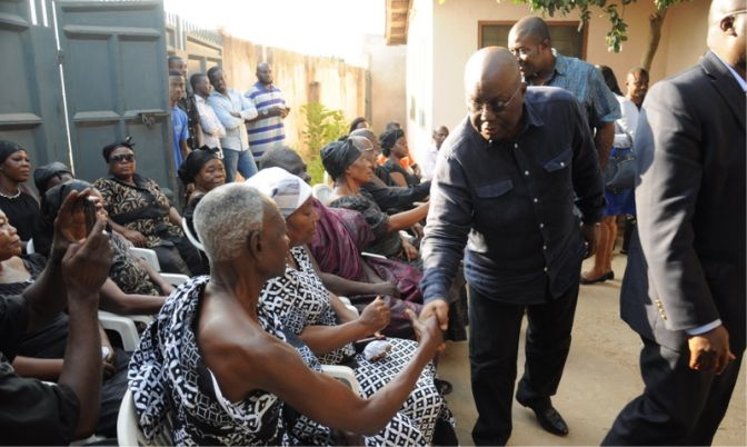 Nana Addo in a handshake with the late Samuel Nuamah's father.