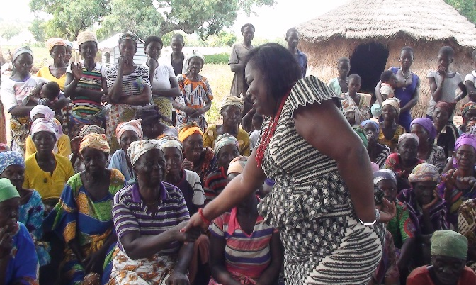 Madam Oye Lithur exchanging pleasantries with some of the women.