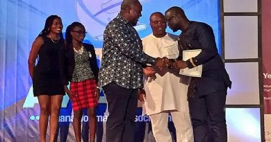 Seth receiving his award from President Mahama.
