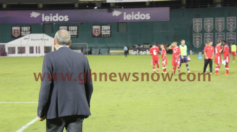 Coach Grant walks onto the field at half time