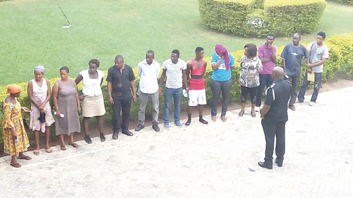 Chief Inspector Ahianyo, Deputy Ashanti Regional Police PRO, speaking to some of suspects after their arrest.
