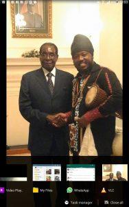 Blak Rasta In a Handshake with President Robert Mugabe