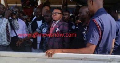 Daniel Obinim being led into a police pickup after his meeting with the Tema DOVSSU boss