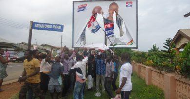 The New Ningo NPP demonstrators chanting under the billboard that had the NPP's torn banner