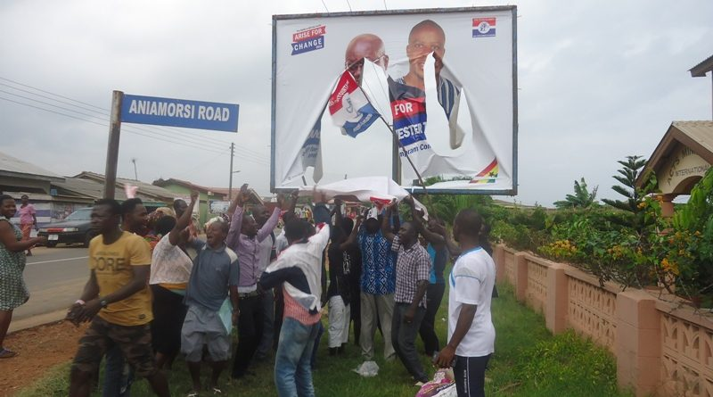 The New Ningo NPP demonstrators chanting under the billboard that had the NPP's torn banner
