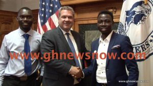 John Obiri Yeboah (R) with Yonkers Mayor Mike Spano (C) and host Bismark Adu