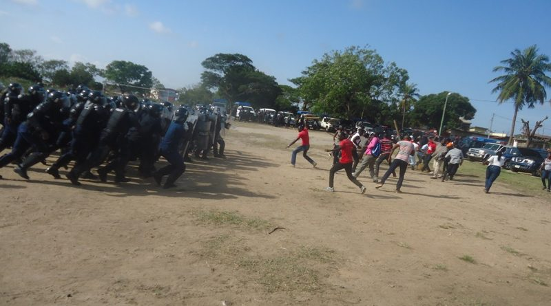 police-in-protective-equipment-closing-down-on-rowdy-crowd-at-a-polling-station-in-the-police-simulation-exercise