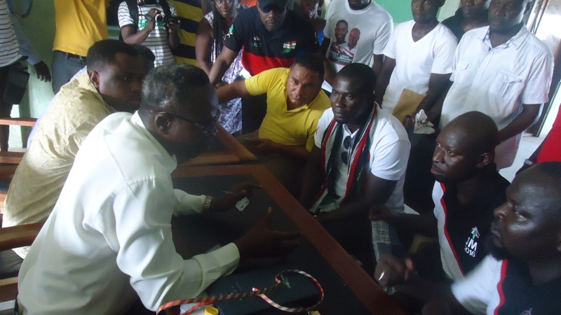 mr-okyerefo-ashaiman-ec-returning-officer-explaining-a-point-to-ernest-norgbey-2nd-left-and-his-team-when-the-latter-went-to-file-his-nomination-forms