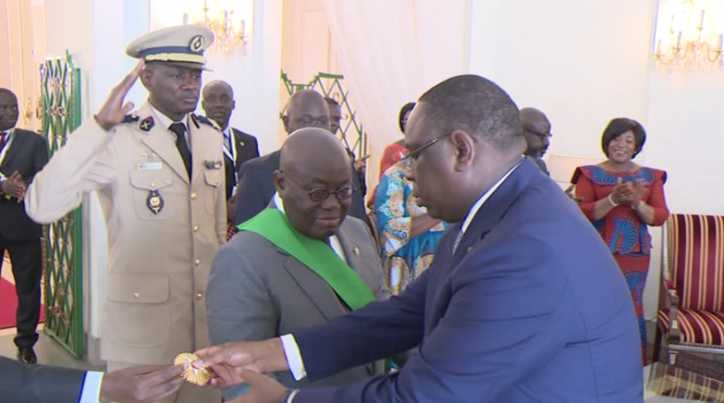 Senegalese President Macky Sall decorating Nana Addo