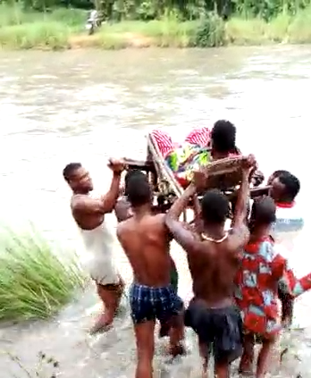 SHOCKING VIDEO: Pregnant Woman Carried Across River To Give Birth