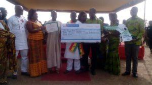 Ibrahim Musa Displaying His Cheque