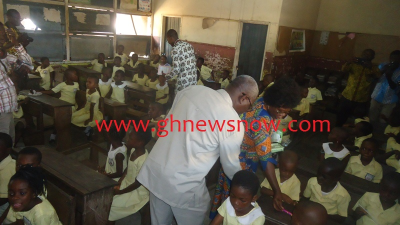 isaac-odamtten-far-left-and-mrs-frempong-kore-distributing-some-writing-materials-to-the-basic-one-pupils-of-star-basic-school-tema-community-5