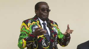 Zimbabwean President Robert Mugabe addresses people at an event before the closure of his party's 16th Annual Peoples Conference in Masvingo, about 300 kilometres south of the capital Harare, Saturday, Dec. 17, 2016. Mugabe officially opened the conference where he is set to be endorsed as the ruling party candidate for Presidential elections set for 2018.(AP Photo/Tsvangirayi Mukwazhi)