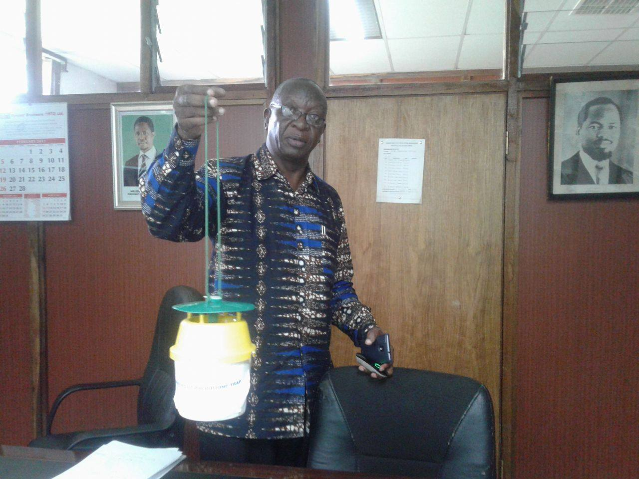Mr Okhoba displaying a newly bought gadget for detecting pests